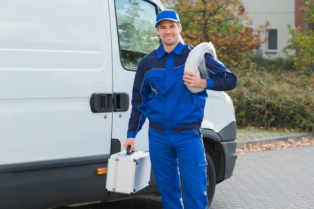plumber; van; worker; toolbox; electrician; repair; service; male; outdoors; happy; person; cable; confident; coil; car; truck; man; maintenance; handyman; vehicle; street; job; technician; carrying; front;
